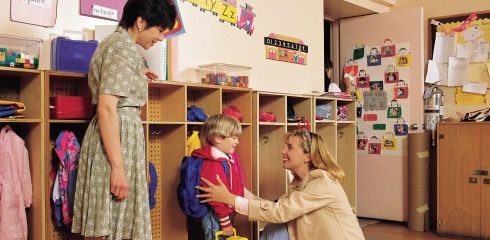 Mother and son in classroom with teacher